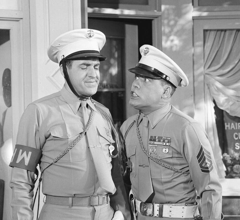 "Jim Nabors (left) grimaces as Frank Sutton trembles with anger in an episode of the television comedy series ""Gomer Pyle, USMC"" called ""Gomer, M.P.,"" February 10, 1965. Photo: CBS Photo Archive, Getty Images / Copyright CBS Broadcasting, Inc. All Rights Reserved. Credit: CBS Photo Archive"