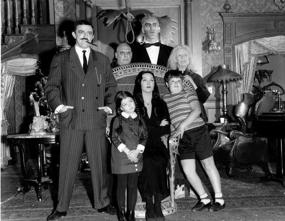 """The Addams Family"" is based on the characters in Charles Addams' ""New Yorker"" cartoons. The wealthy Gomez Addams (John Astin, left) was madly in love with his wife, Morticia (Carolyn Jones, seated), and their two children, Wednesday (Lisa Loring) and Pugsley (Ken Weatherwax). The family, including Uncle Fester (Jackie Coogan), their towering butler Lurch (Ted Cassidy), Grandmama (Blossom Rock), and Thing, a hand that usually appeared out of a small wooden box, resided in an ornate, gloomy mansion. Sept. 18, 1964. Photo: ABC PHOTO ARCHIVES, Getty Images / ©1964, ABC Photo Archives. All rights reserved. For editorial use only. NO ARCHIVING, NO RESALE."