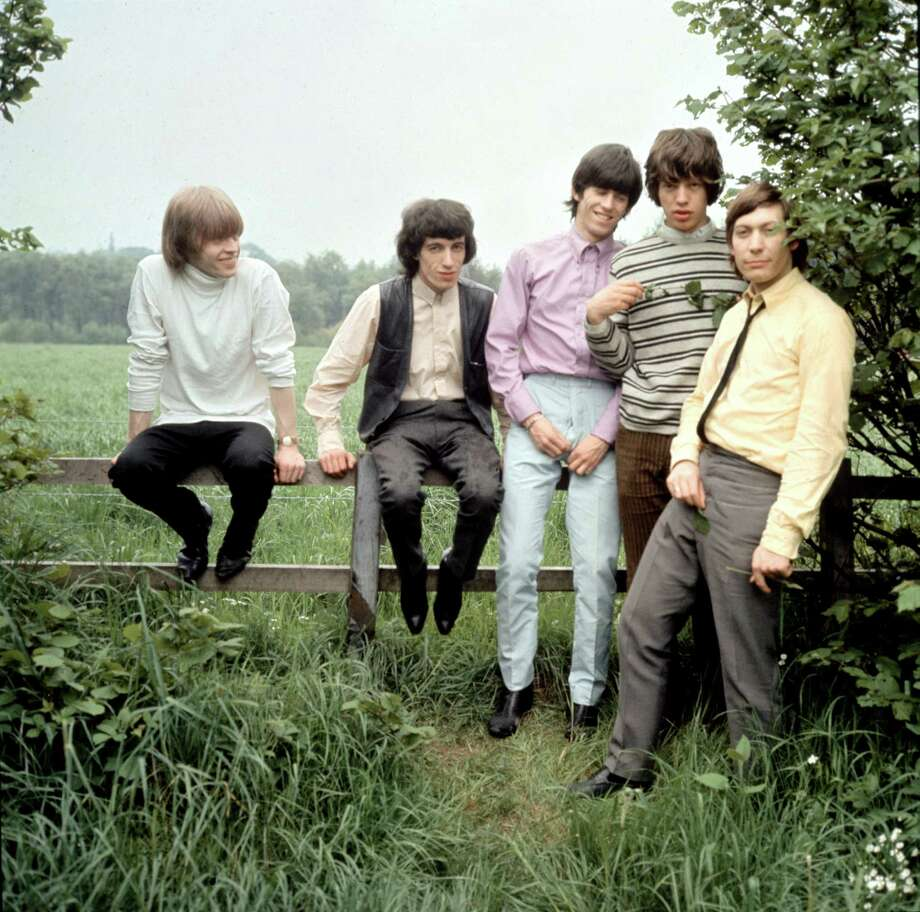 The Rolling Stones — Brian Jones, Bill Wyman, Keith Richards, Mick Jagger and Charlie Watts — pose for a picture in the countryside, 1964. Photo: Michael Ward, Getty Images / 2011 Michael Ward