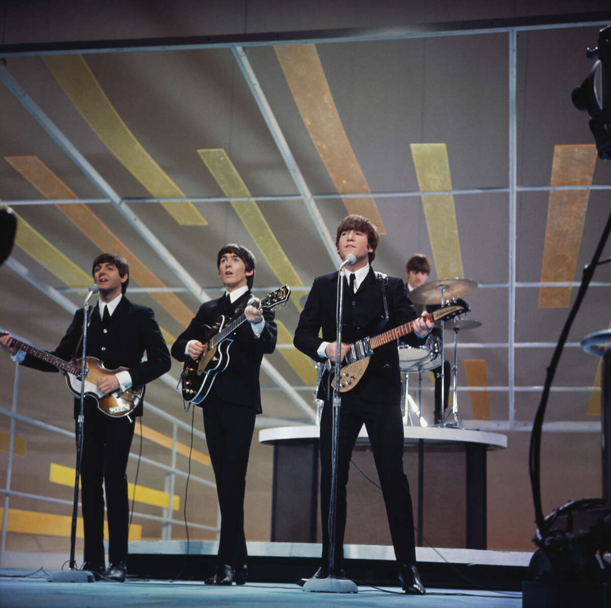 The Beatles - Paul McCartney (from left), George Harrison, John Lennon and Ringo Starr - performing on the Ed Sullivan Show in New York City, Feb. 9, 1964.
