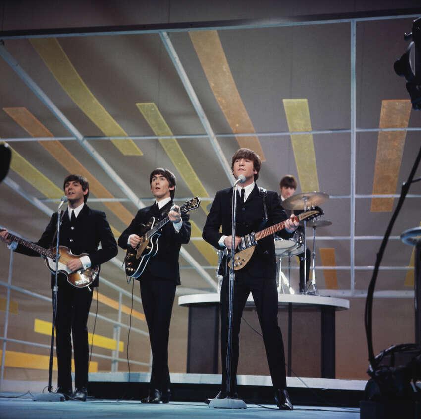 The Beatles - Paul McCartney (from left), George Harrison, John Lennon and Ringo Starr - performing on the Ed Sullivan Show in New York City, Feb. 9, 1964.