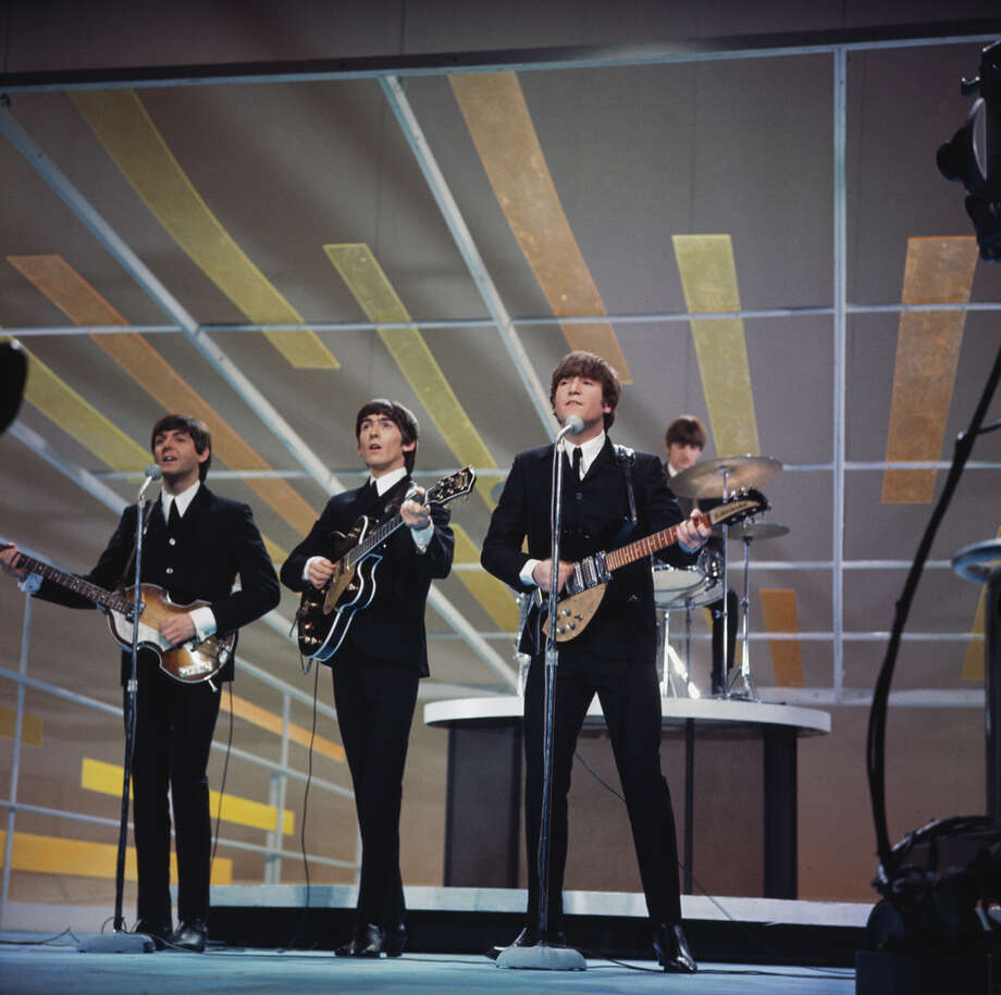 The Beatles — Paul McCartney (from left), George Harrison, John Lennon and Ringo Starr — performing on the Ed Sullivan Show in New York City, Feb. 9, 1964. Photo: Paul Popper/Popperfoto, Getty Images / 2011 Getty Images
