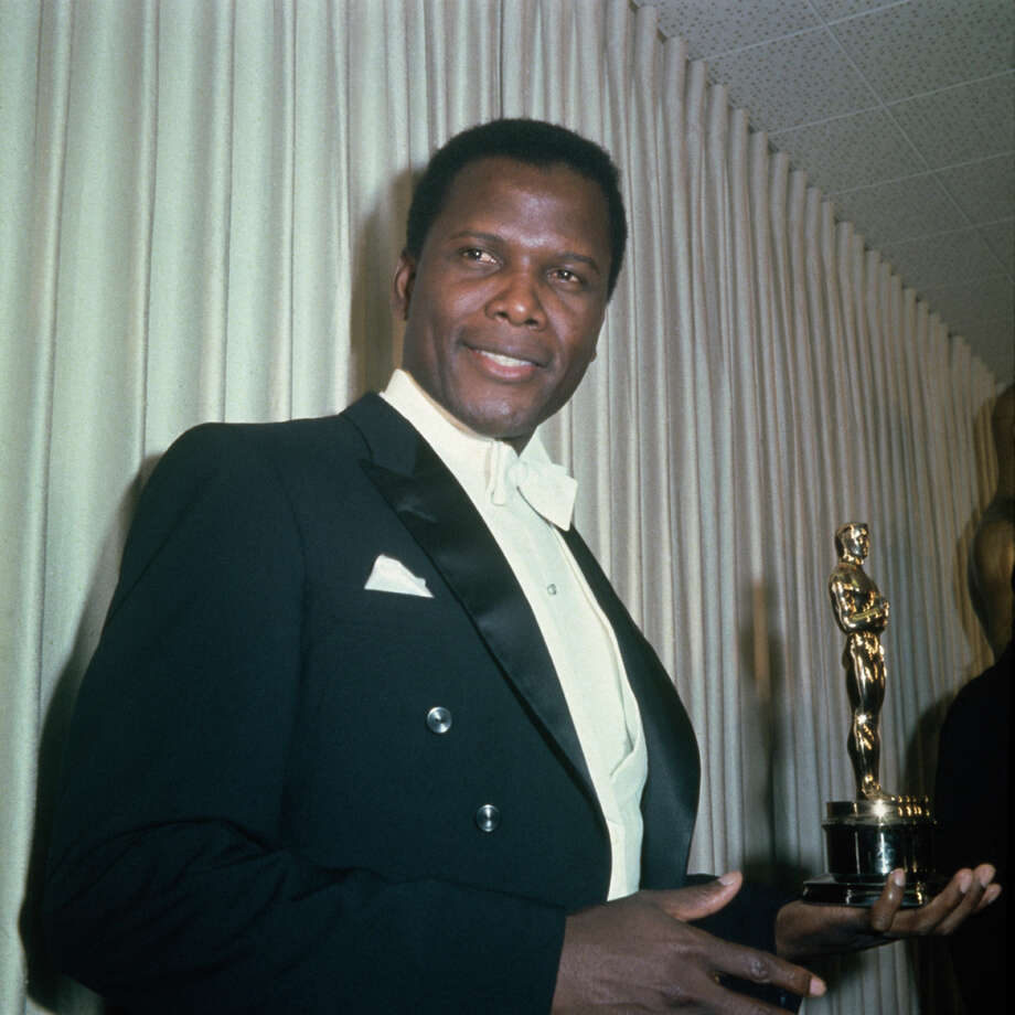 "Actor Sidney Poitier holds his Academy Award for ""Lilies Of The Field,"" directed by Ralph Nelson, at the 36th Academy Awards ceremony, on April 13, 1964; he was the first black person to win the Oscar for Best Actor. Photo: Archive Photos, Getty Images / 2010 Getty Images"