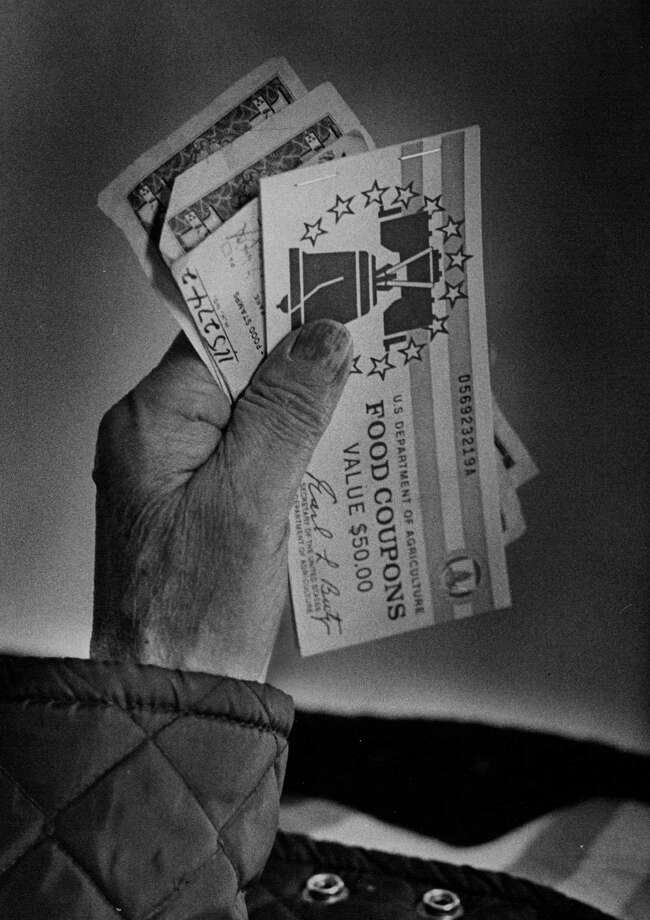 Food stamps are seen in 1976. The Food Stamp Act of 1964 was the country's first permanent food stamp program. Photo: Duane Howell, Getty Images / (C) 2010 The Denver Post, MediaNews Group