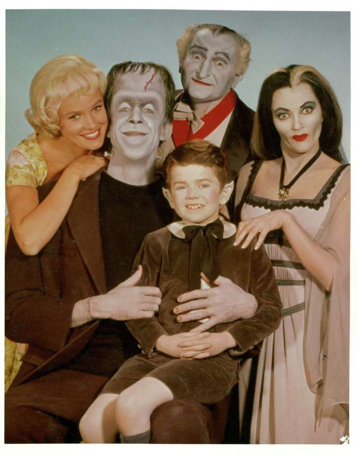 "Pat Priest, Al Lewis and Butch Patrick along with Fred Gwynne and Yvonne De Carlo of the Munster family in a publicity photograph from the television series ""The Munsters,"" circa 1964. Photo: Archive Photos, Getty Images / 2012 Getty Images"