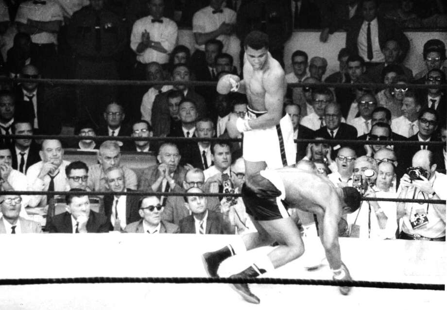 Cassius Clay (later Muhammad Ali) lands a left hook knocking out Sonny Liston during the fight at Convention Hall on Feb. 25, 1964, in Miami Beach, Fla. Clay won the World Heavyweight Title by a RTD 6. Photo: The Ring Magazine, Getty Images / 2012 The Ring Magazine
