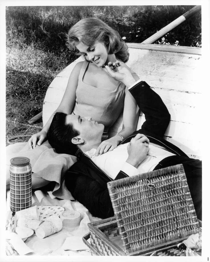 "Ann-Margret and Elvis Presley enjoying a picnic together in a scene from the film ""Viva Las Vegas,"" 1964. Photo: Archive Photos, Getty Images / 2012 Getty Images"
