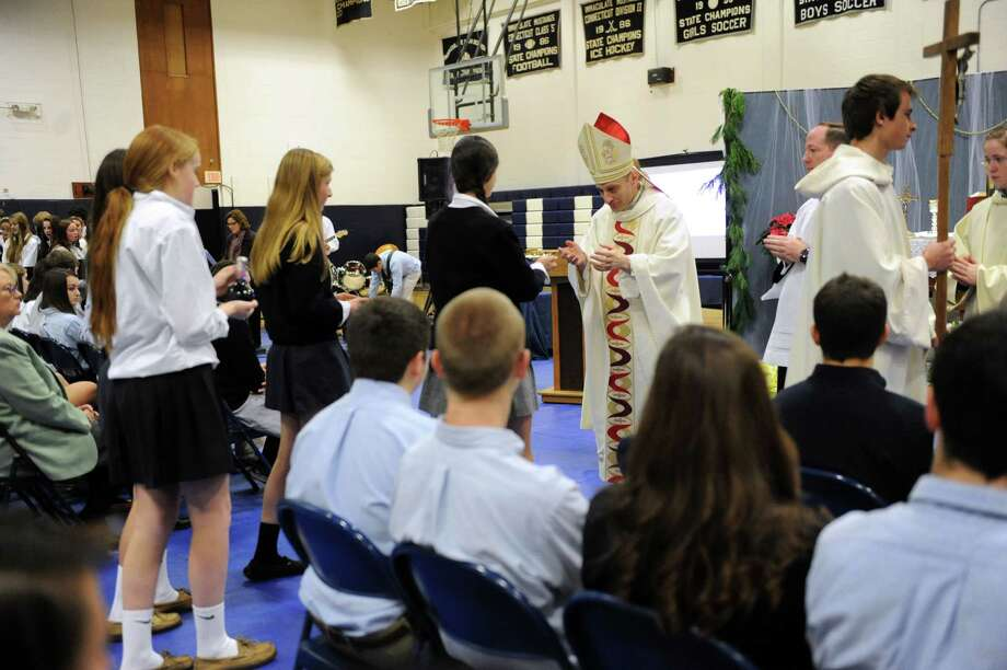 Bishop Frank J. Caggiano, bishop of the diocese of Bridgeport, Conn. leads Mass during a visit to Immaculate High School in Danbury, Conn. Monday, Dec. 9, 2013. Photo: Carol Kaliff / The News-Times