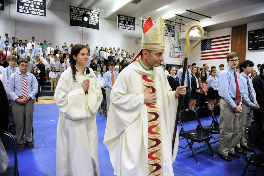 Bishop Frank J. Caggiano, bishop of the diocese of Bridgeport, Conn. celebrates Mass during a visit to Immaculate High School in Danbury, Conn. Monday, Dec. 9, 2013. Photo: Carol Kaliff / The News-Times