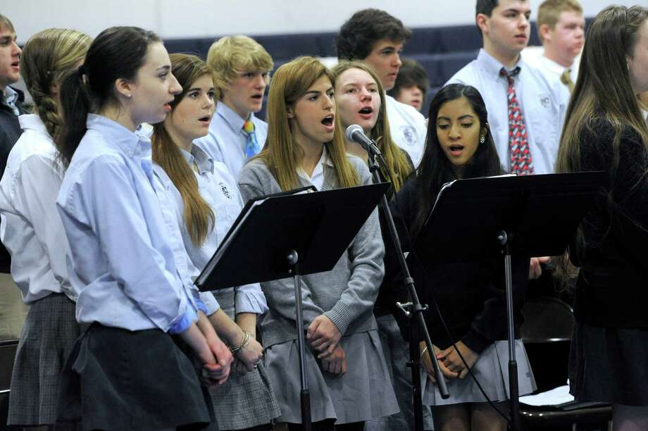 The school chorus sings during Bishop Frank J. Caggiano, bishop of the diocese of Bridgeport, Conn. visit to Immaculate High School in Danbury, Conn. Monday, Dec. 9, 2013. Photo: Carol Kaliff / The News-Times