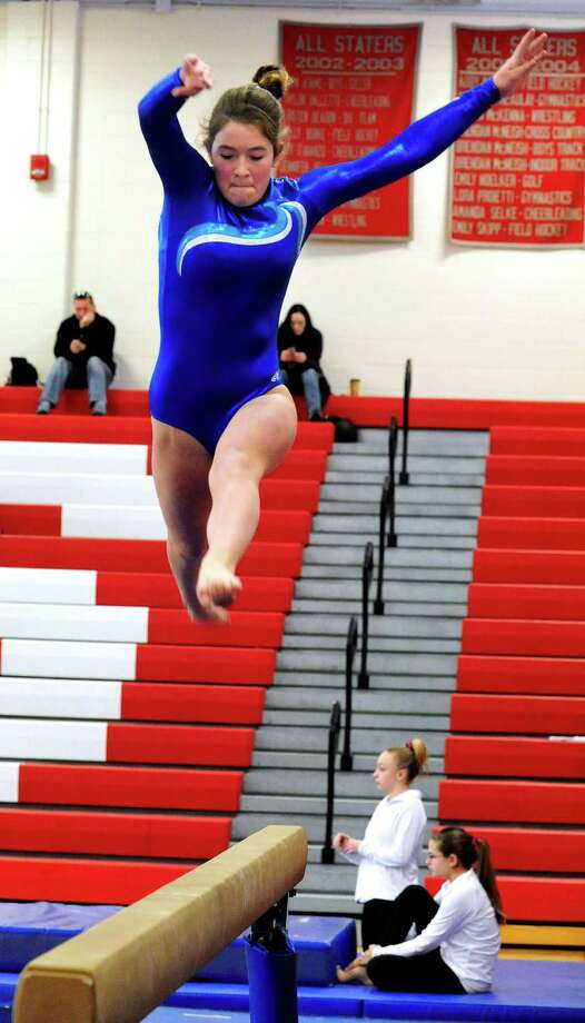Samantha Gunn competes for Darien High School on balance beam at the Pomperaug Invitational gymnastics meet in Southbury Saturday, Jan. 5, 2013. Photo: Michael Duffy / The News-Times