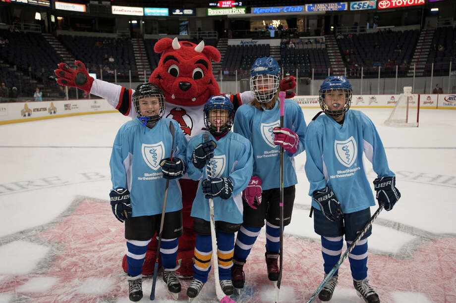 BlueShield's Little Bluesers took to the ice during an Albany Devils home game on Nov. 30. Invited by BlueShield, youth hockey players participated in a game of Score-O in between the first and second period with cheers of encouragement from Devil Dawg. The winner from this shoot-out, and subsequent shoot-outs, will come back for the championship at the final Devils home game on April 19. (Albany Devils / James DiBianco) Photo: James DiBianco / Copyright 2013 James DiBianco