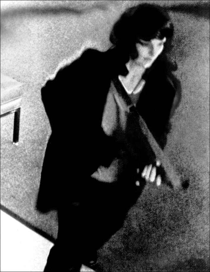 This file photo released by the FBI and taken from a security camera shows Patricia Hearst, granddaughter of American newspaper tycoon William Randolph Hearst, during a bank robbery in San Francisco on April 17, 1974. Former President Bill Clinton pardoned Hearst hours before he left office on Jan. 21, 2001. Hearst, who was kidnapped Feb. 4, 1974 by the radical Symbionese Liberation Army, claimed she was brainwashed by her kidnappers into helping them rob the bank. Photo: AFP, Getty Images / AFP