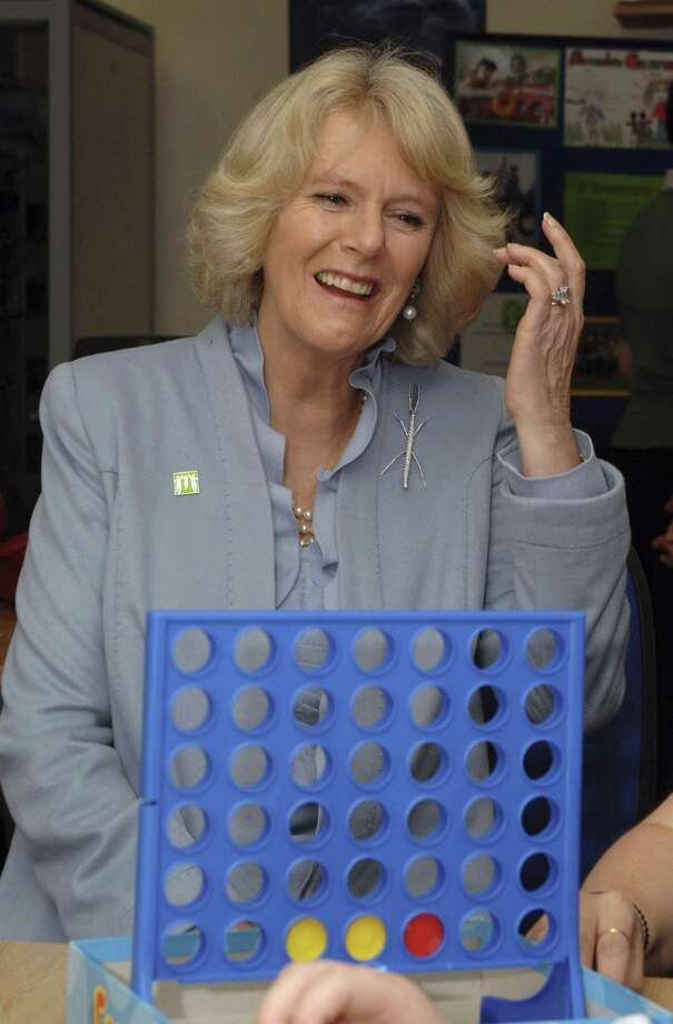 Camilla, Duchess of Cornwall, plays Connect Four while visiting the Barnado's CareFree Project on Feb. 8, 2008, in Leicester, England. The children's charity offers practical and emotional support services to children up to age 18 who act as carers for family members. Photo: Anwar Hussein Collection/ROTA, Getty Images / 2008 Anwar Hussein