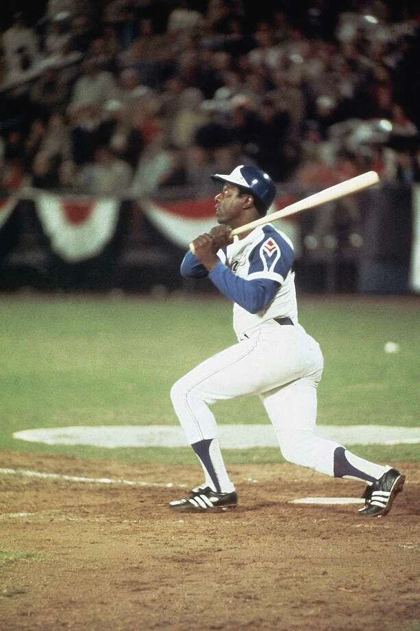 The Atlanta Braves' Hank Aaron hits home run No. 715 to break Babe Ruth's record off  the Los Angeles Dodgers' Al Downing in Fulton County Stadium in Atlanta on April 8, 1974. Photo: Herb Scharfman/Sports Imagery, Getty Images / 1974 Herb Scharfman/Sports Imagery