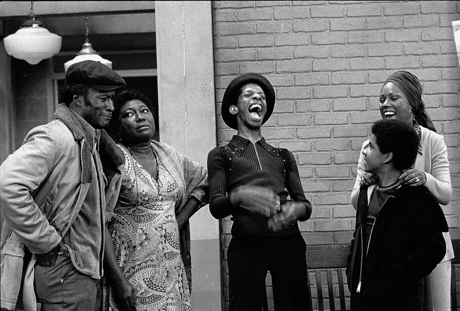 "Actors John Amos (from left), Esther Rolle, Jimmy Walker, Ralph Carter and Ja'net DuBois share a laugh in a scene from the sitcom ""Good Times,"" 1974. Photo: CBS Photo Archive, Getty Images / 2005 CBS WORLDWIDE INC."