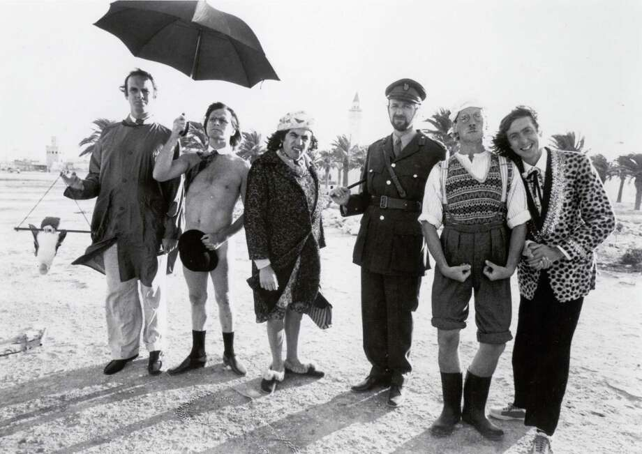 "Cast members of ""Monty Python's Flying Circus"" — John Cleese, Terry Gilliam, Terry Jones, Graham Chapman, Michael Palin and Eric Idle — line up on a beach in this undated photo. 1974 marked the end of the series in the United Kingdom, and its debut on U.S. television at KERA-TV in Dallas. Photo: Associated Press / PYTHON (MONTY) PICTURES, LTD."