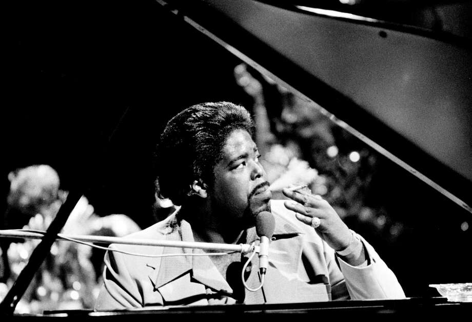 "Barry White performs in Hilversum, Netherlands in 1974, around the time his album was released. The title track, ""Can't Get Enough of Your Love, Babe,"" and ""You're the First, the Last, My Everything"" were White's two biggest hits. Photo: Gijsbert Hanekroot, Getty Images / 1974 Gijsbert Hanekroot"