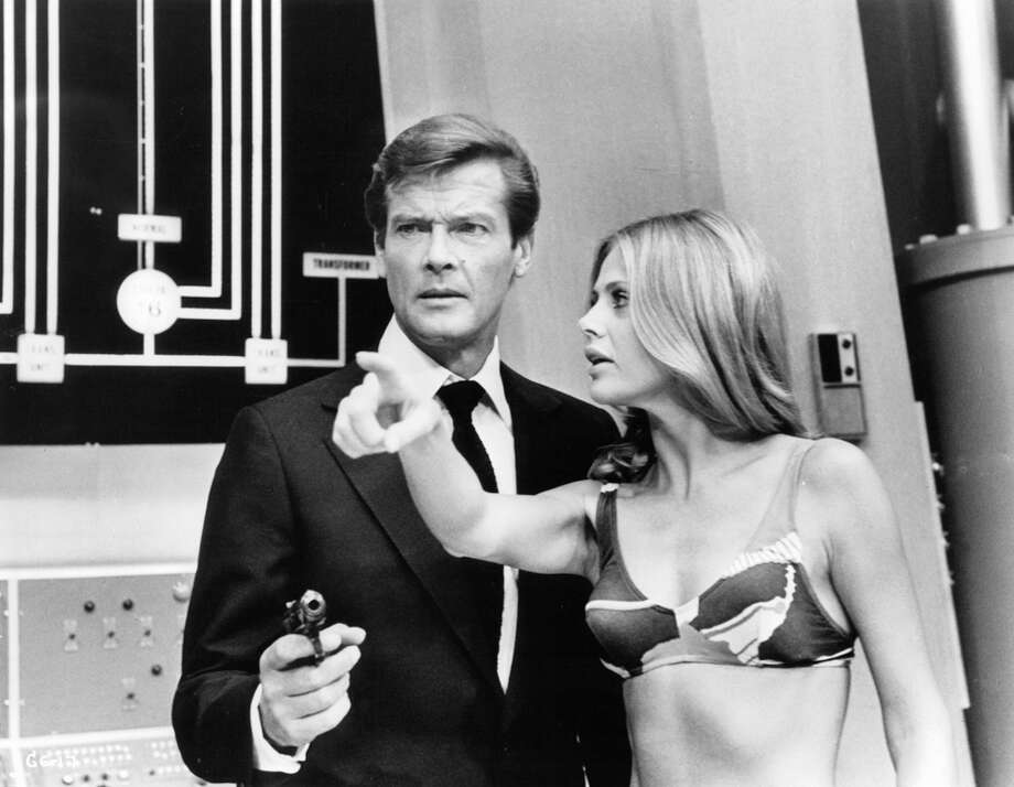 "Roger Moore points a gun and Britt Ekland points her finger in a scene from the James Bond film ""The Man With The Golden Gun,"" 1974. Photo: Archive Photos, Getty Images / 2011 Getty Images"