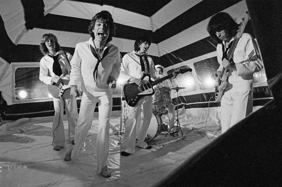 "The Rolling Stones — Mick Taylor (from left), Mick Jagger, Keith Richards, Charlie Watts and Bill Wyman — pose during the production of their music video for ""It's Only Rock 'n Roll (But I Like It)"" in June 1974 in London. Photo: Michael Putland, Getty Images / 2013 Michael Putland"