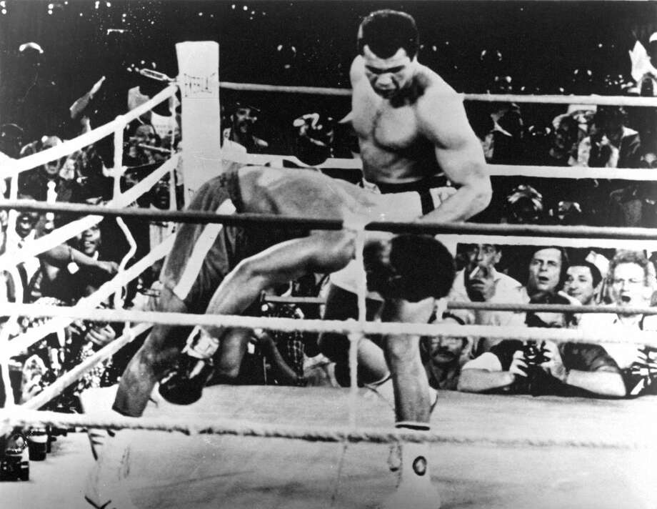 "Former champion Muhammad Ali lands a left hook knocking out undefeated world heavyweight champion George Foreman during ""The Rumble in the Jungle"" fight at the Mai 20 Stadium in Kinshasa, Zaire,  on Oct. 30, 1974. Photo: The Ring Magazine, Getty Images / 2012 The Ring Magazine"