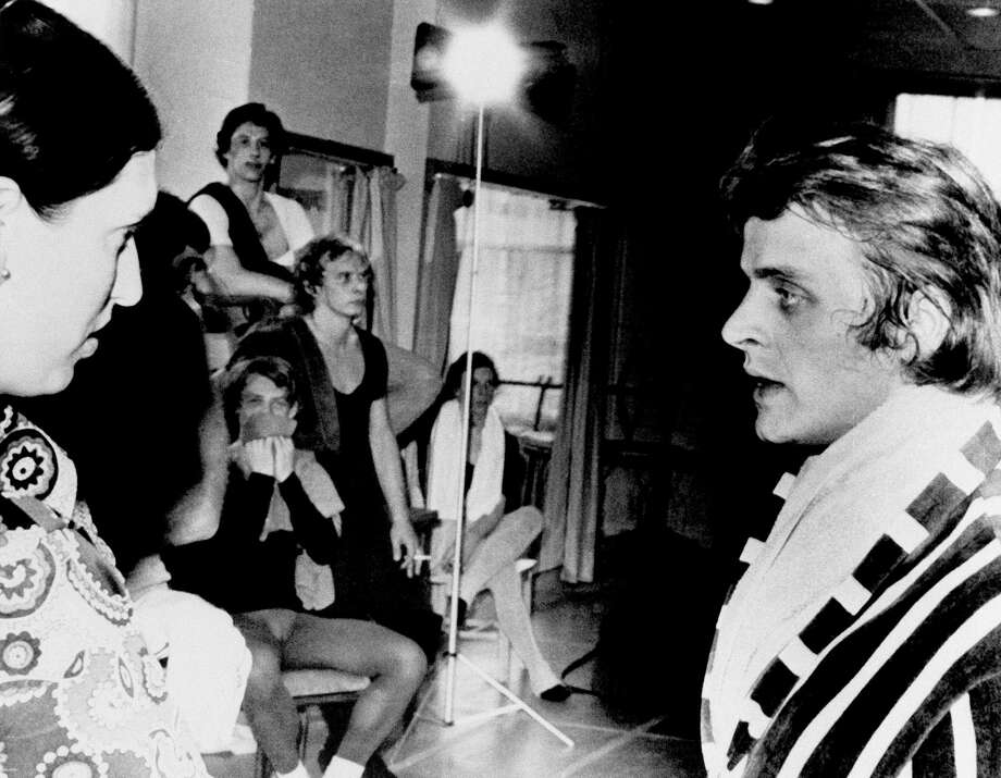 Russian Ballet Star Mikhail Baryshnikov (right) talks with his manager Dina Makarova (left) at his first public appearance since his defection to Canada on July 10, 1974 in Toronto, Canada. The former Bolshoi Ballet member was rehearing with members of the National Ballet of Canada who were trying to work out a contract with him. Photo: JH, Associated Press / AP1974