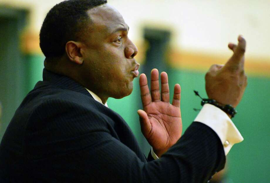 Green Tech head coach Jamil Hood Sr., calls out to his players during Saturday's game with East High at Green Tech Charter School Dec. 7, 2013, in Albany, NY.   (John Carl D'Annibale / Times Union) Photo: John Carl D'Annibale / 00024928A