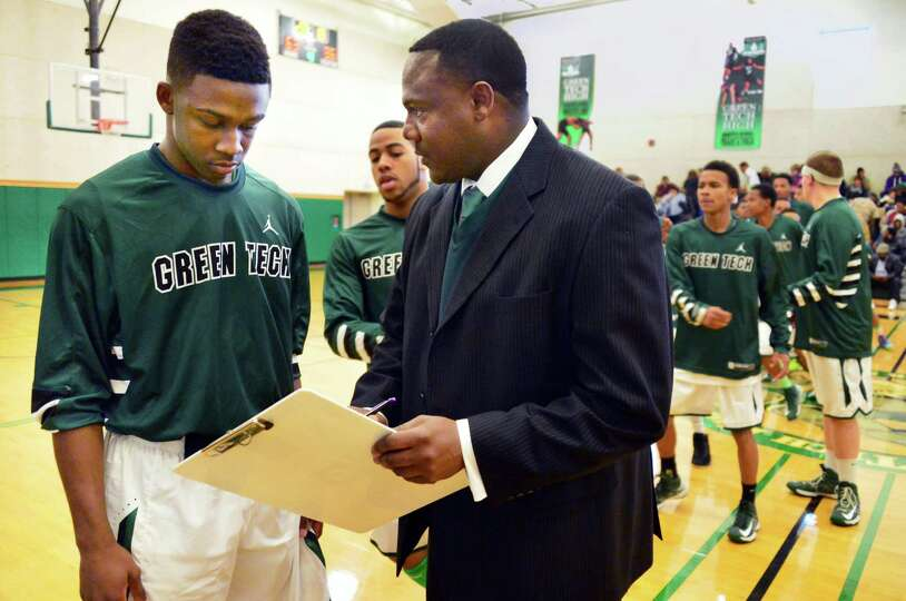 Jamil Hood Jr., left, with his father, Green Tech head coach Jamil Hood Sr.,during Saturday's game w