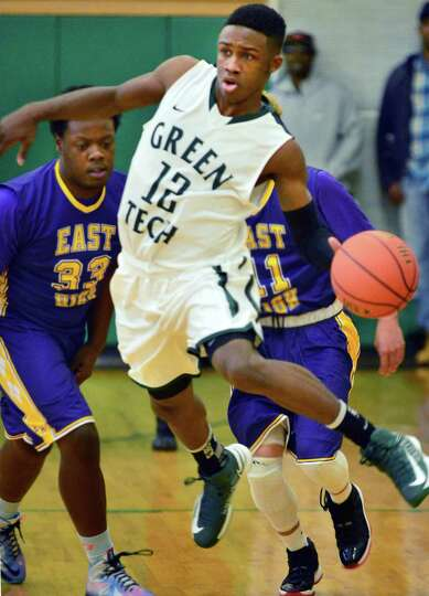 Green Tech's #12 Jamil Hood Jr.,is double teamed by East High's defense as he brings the downcourt d