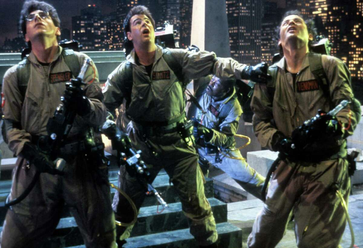 """Harold Ramis, Dan Aykroyd, and Bill Murray in a scene from the film """"Ghostbusters,"""" 1984. Related Slideshow: More movies turning 30 in 2014"""