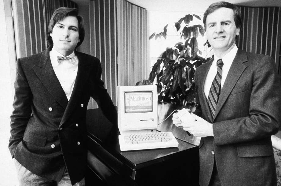Apple Computers chairman Steve Jobs and president John Sculley pose with the new Macintosh personal computer in New York City on Jan. 16, 1984. Photo: Marilyn K. Yee, Getty Images / Archive Photos