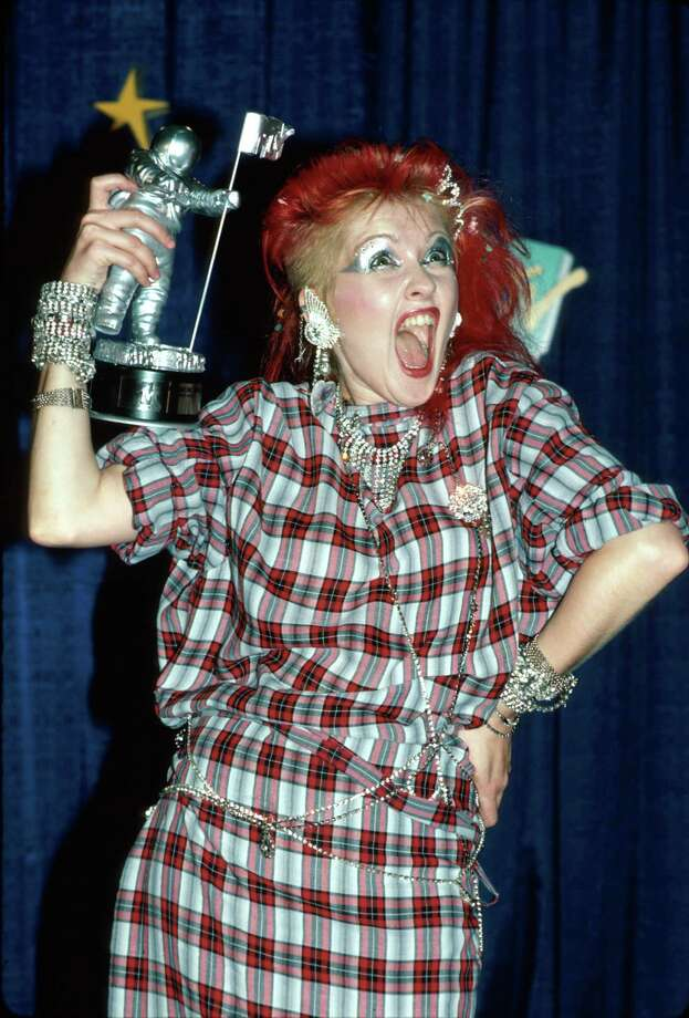 "Singer Cyndi Lauper holds her moon man after winning the award for Best Female Video for ""Girls Just Want to Have Fun,"" at the MTV Video Music Awards on Sept. 14, 1984. Lauper may have won, but Madonna's risqué live performance of ""Like a Virgin"" was the talk of the night. The Cars' ""You Might Think"" won Video of the Year, but Herbie Hancock took home the most awards (five) for his video  ""Rockit."" Photo: David McGough, Getty Images / Time Life Pictures"