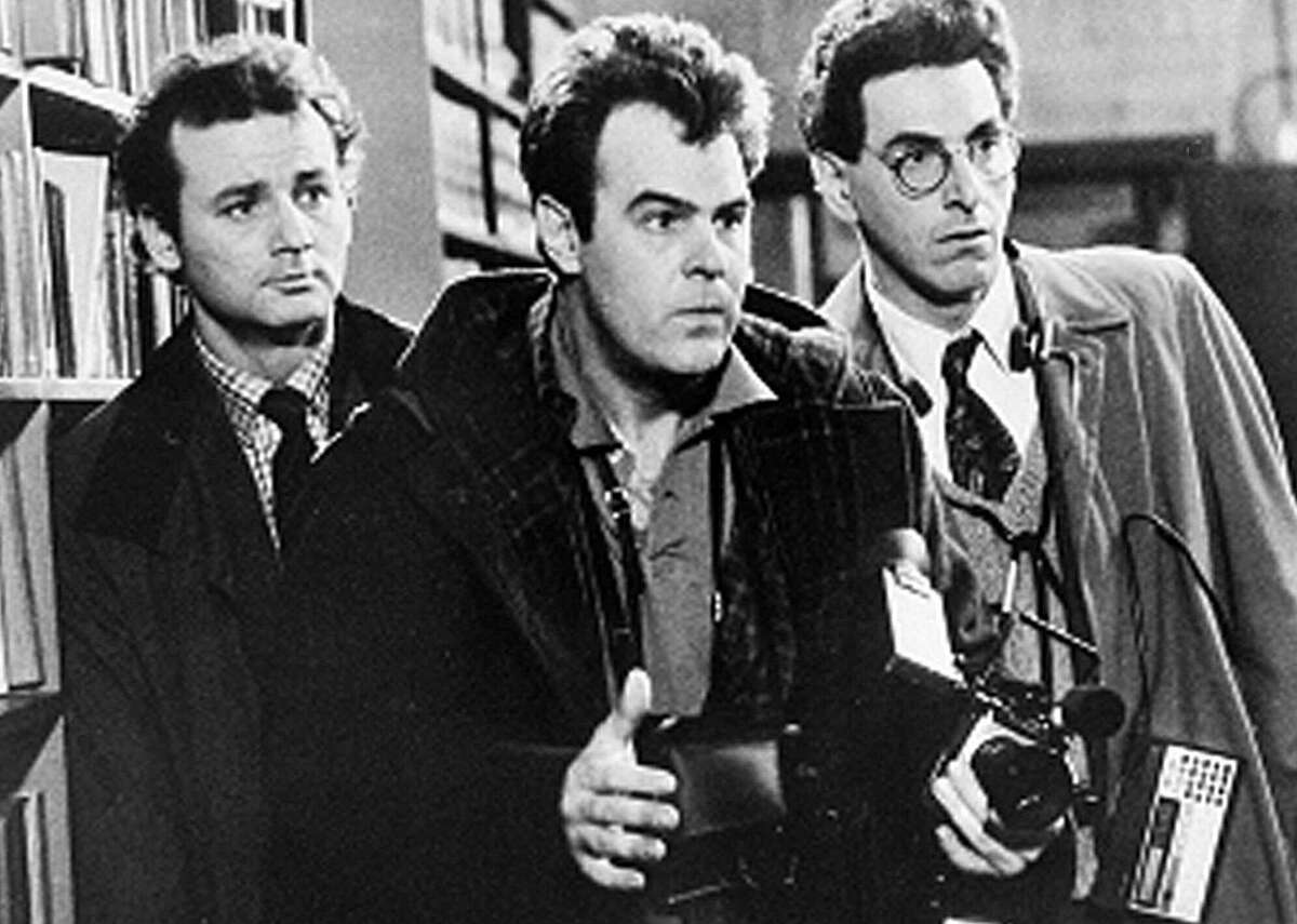 Bill Murray, Dan Aykroyd and Harold Ramis approach a ghost in a scene from