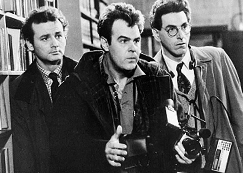 Bill Murray, Dan Aykroyd and Harold Ramis approach a ghost in a scene from