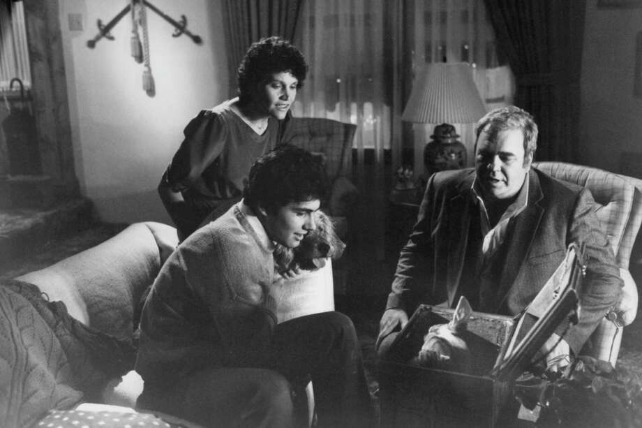 "Zach Galligan, Frances Lee McCain and Hoyt Axton look into a box in a scene from the film ""Gremlins,"" 1984. Photo: Michael Ochs Archives, Getty Images / 2011 Getty Images"