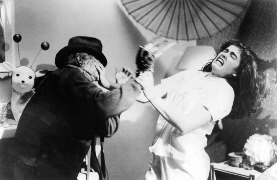 "Robert Englund attacks Heather Langenkamp in a scene from the film ""A Nightmare on Elm Street,"" 1984. Photo: Michael Ochs Archives, Getty Images / 2012 Getty Images"
