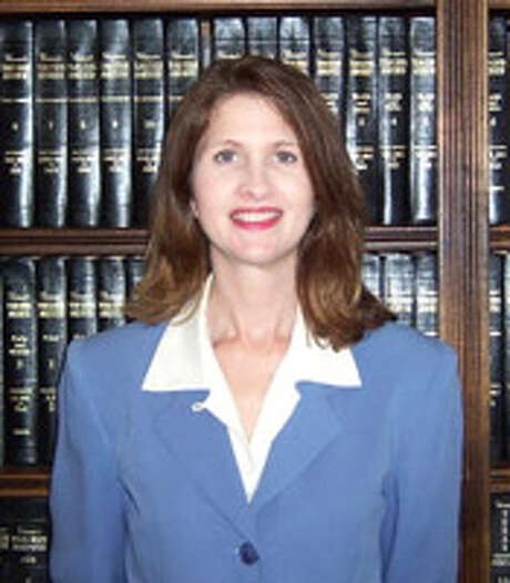 """Caption: Judge Elizabeth E. Coker oversees the 258th district court that covers Polk, San Jacinto and Trinity counties. Coker is accused of the """"very unethical"""" practice of sending text messages from the bench to an assistant district attorney to help bolster the prosecution's case during a trial, according to an investigator's report.   Credit: Trinity County Photo: Trinity County / Trinity County"""