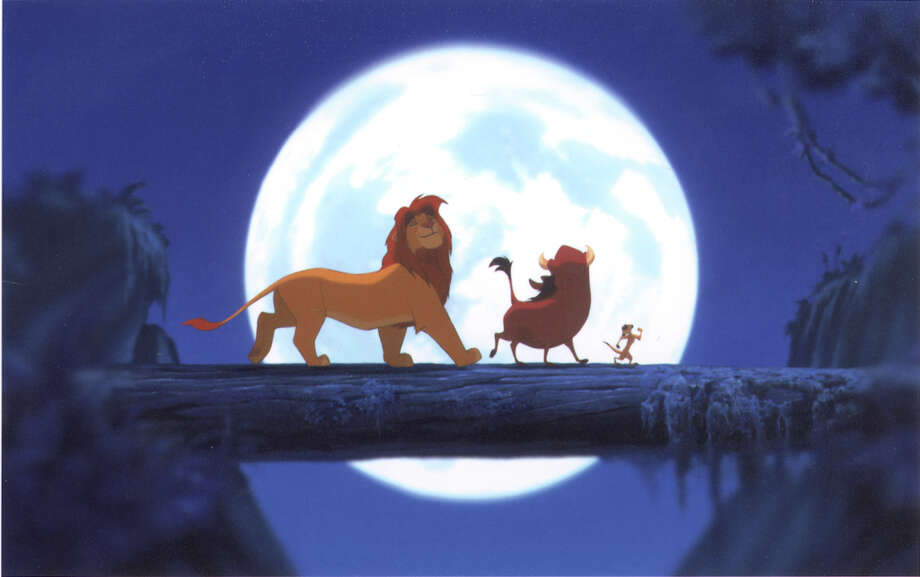 """Simba (left) falls in line with Timon (right) and Pumbaa's (center) """"hakuna matata"""" philosophy as he grows from cub to adult lion in the animated film """"The Lion King."""" Photo: Getty Images / DISNEY ENTERPRISES"""
