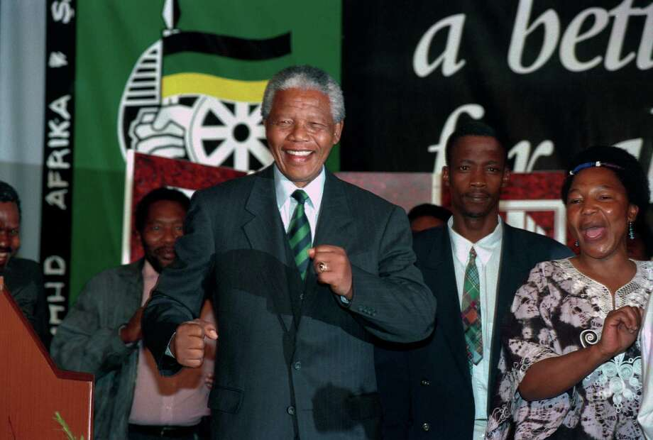 President Nelson Mandela of South Africa celebrates his win in the first democratic election in South Africa at the ANC victory party on May 2, 1994, at Carlton Hotel in Johannesburg. Photo: Per-Anders Pettersson, Getty Images / 1994 Per-Anders Pettersson