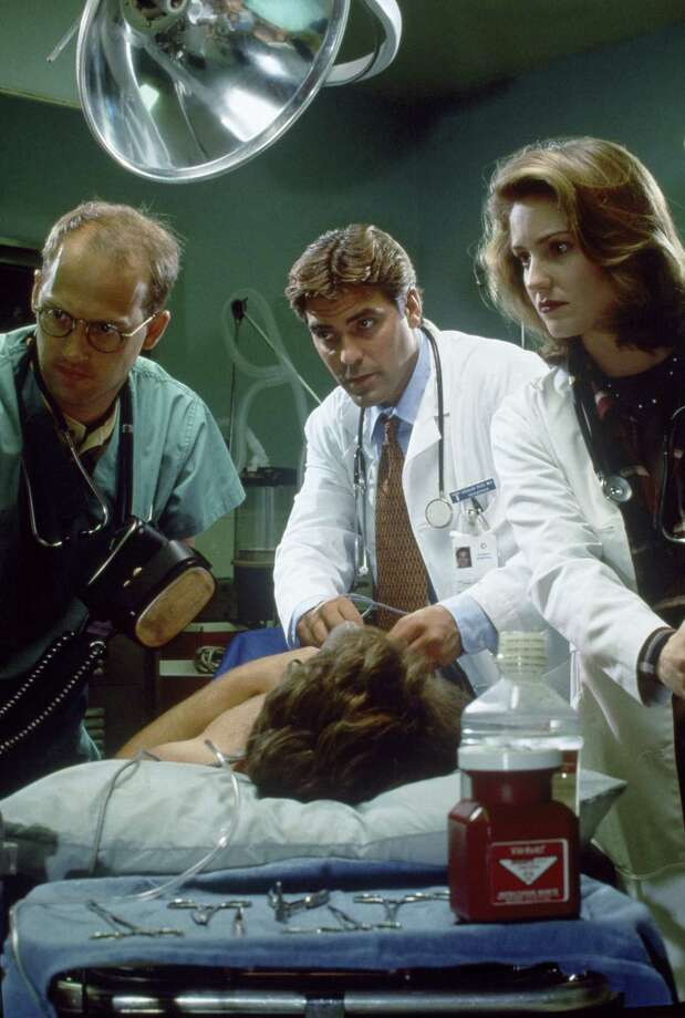 Anthony Edwards as Dr. Mark Greene (from left), George Clooney as Dr. Doug Ross and Sherry Stringfield as ER Resident Dr. Susan Lewis in a season one episode of the medical drama. Photo: NBC, Getty Images / © NBC Universal, Inc.