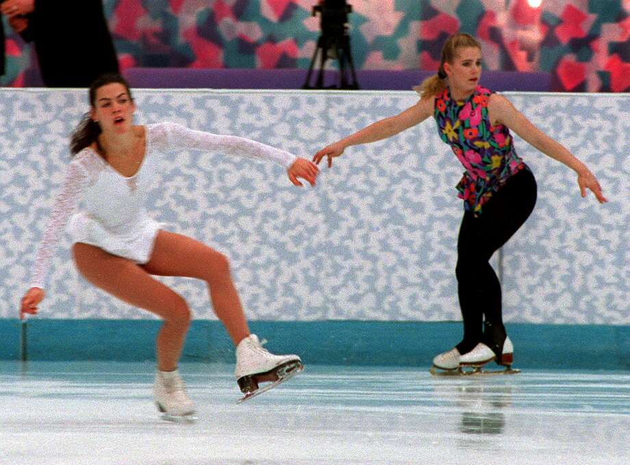 Nancy Kerrigan and Tonya Harding in practice together in Norway for the Winter Olympics in Lillehammer on Feb. 17, 1994.  Photo: Boston Globe, Getty Images / 2011 - The Boston Globe