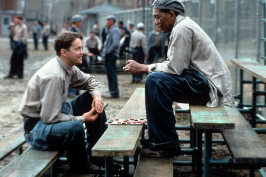 "Tim Robbins and Morgan Freeman sitting outside on the benches playing checkers and talking in a scene from the film ""The Shawshank Redemption,"" 1994. Photo: Archive Photos, Getty Images / 2012 Getty Images"