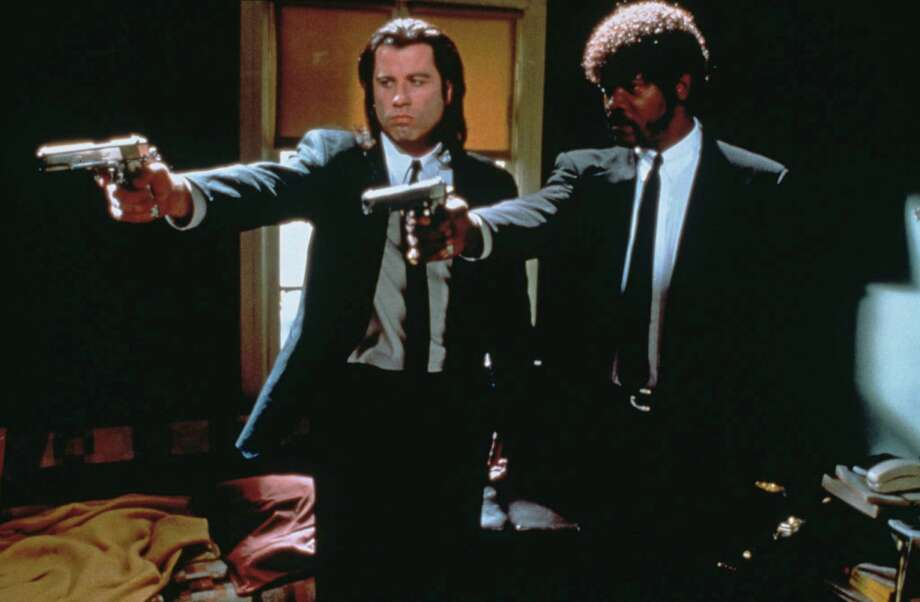 "Actors John Travolta (left) as Vincent Vega and Samuel L. Jackson as Jules Winnfield in a scene from ""Pulp Fiction,"" directed by Quentin Tarantino, 1994. Photo: Hulton Archive, Getty Images / 2012 Getty Images"