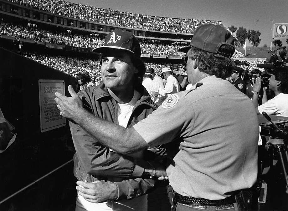 Tony La Russa, receiving congratulations from a Coliseum security guard after winning a third straight pennant, presided over a golden age of Oakland baseball. Photo: Chronicle File