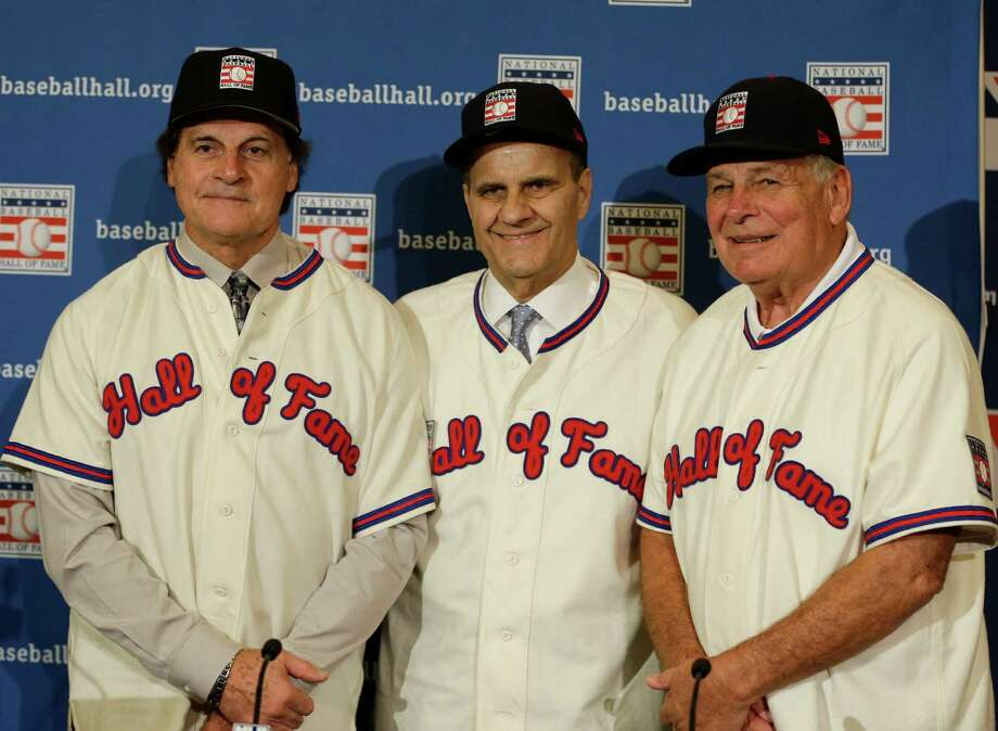 Retired managers, from left, Tony La Russa, Joe Torre and Bobby Cox gather for a photo after it was announced that they were unanimously elected to the baseball Hall of Fame during MLB winter meetings in Lake Buena Vista, Fla., Monday, Dec. 9, 2013.(AP Photo/John Raoux) ORG XMIT: FLJR102 Photo: John Raoux / AP