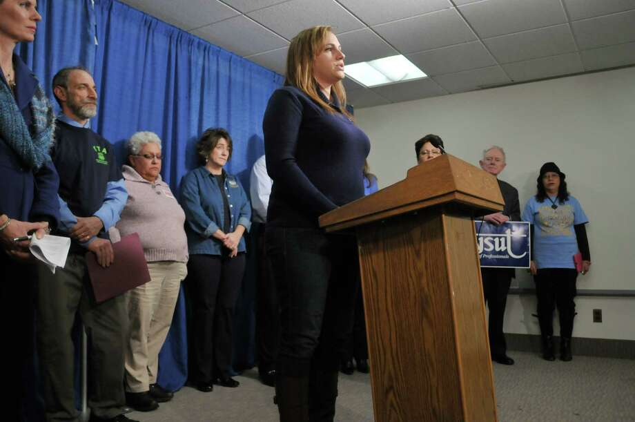 Kerensa Rybak, a parent of five school age children and PTA co-president, Gowana Middle School, talks about how upset some children are on the day of testing in their schools, during a press conference at the Legislative Office Building on Monday, Dec. 9, 2013 in Albany, NY.  The press event was held by Parents, educators, union members and community members for what they were calling a statewide Day of Action to reclaim the promise of public education.  The groups and individuals at the press conference were calling for greater state investment in public schools and colleges, a renewed focus on teaching and learning instead of testing.   (Paul Buckowski / Times Union) Photo: PAUL BUCKOWSKI / 00024950A