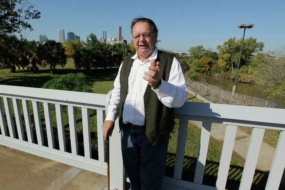 Kirk Farris stands on the Jensen Drive bridge. He's worked to preserve many downtown bridges that span the bayou. His latest efforts include helping TxDOT plan the paint scheme for the Jensen Drive bridge. Photo: James Nielsen, Staff / © 2013  Houston Chronicle