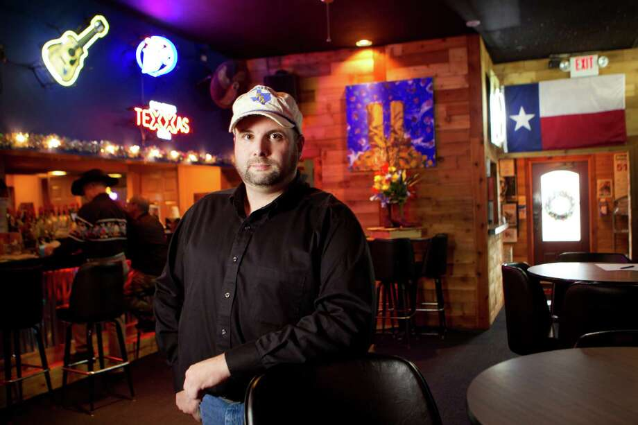Justin Galloway, a manager at Neon Boots Dancehall & Saloon, bought insurance at the healthcare.gov web site and chose a preferred provider organization. He was previously uninsured. Photo: Brett Coomer, Staff / © 2013 Houston Chronicle