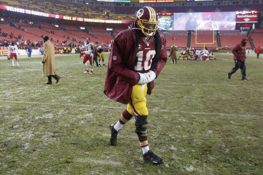 For Robert Griffin III, who hasn't been the same since his knee injury, falling down is part of the NFL process. Photo: Evan Vucci / Associated Press