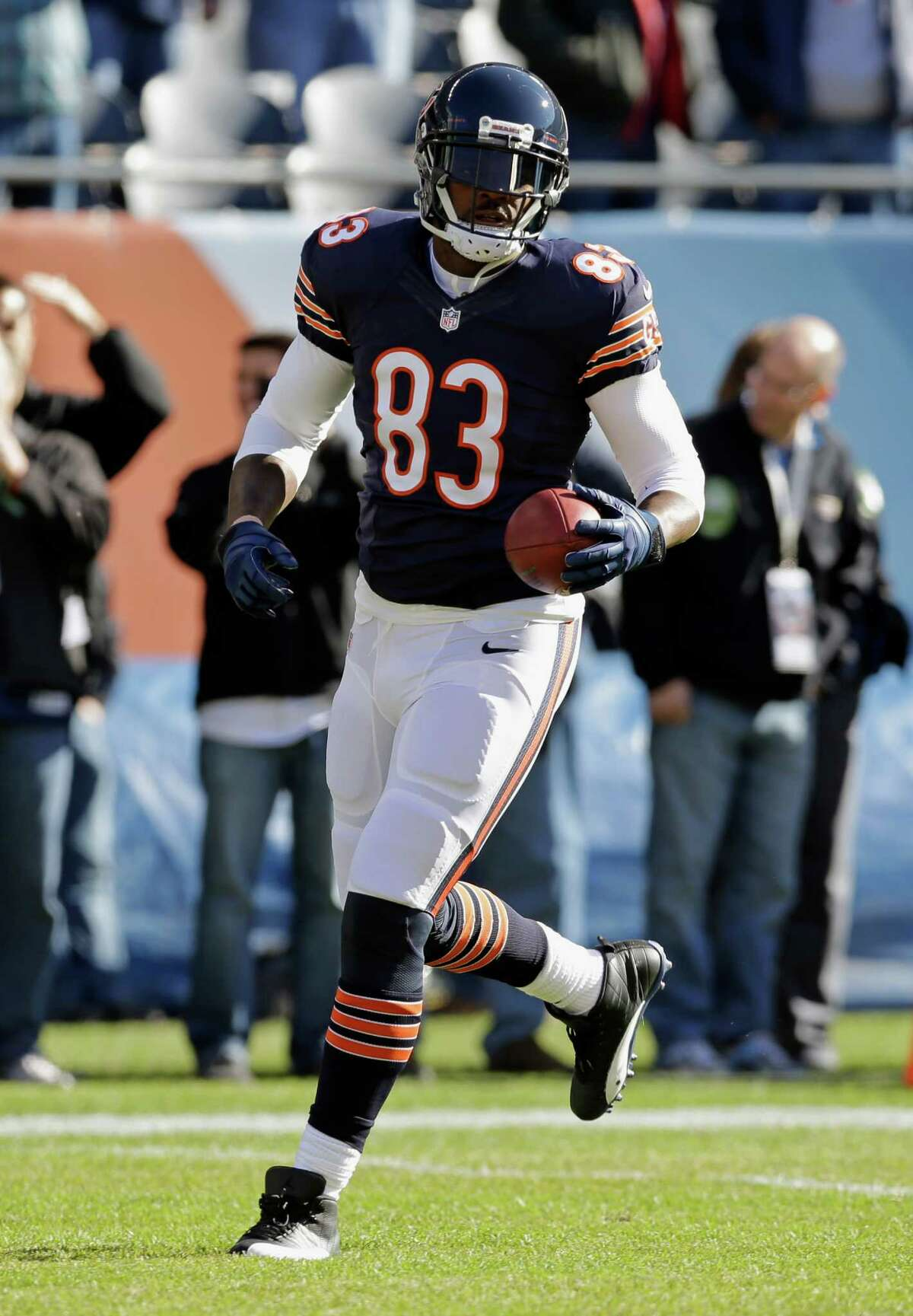 Chicago Bears tight end Martellus Bennett (83) warms up before an NFL football game against the Detroit Lions, Sunday, Nov. 10, 2013, in Chicago. (AP Photo/Nam Y. Huh)